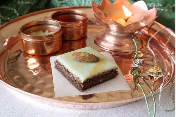 Chocolate burfi piece in a Raksha Bandhan thali.