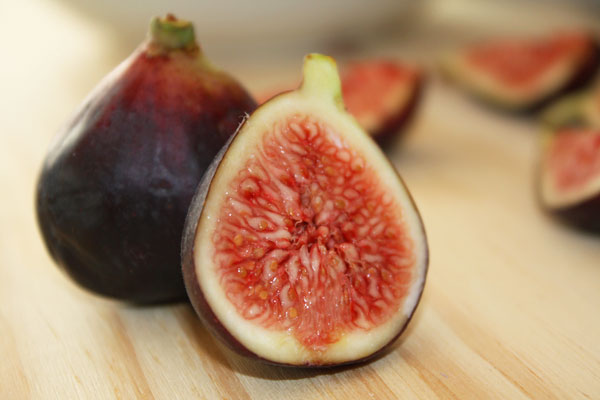 Fresh fig sliced open.