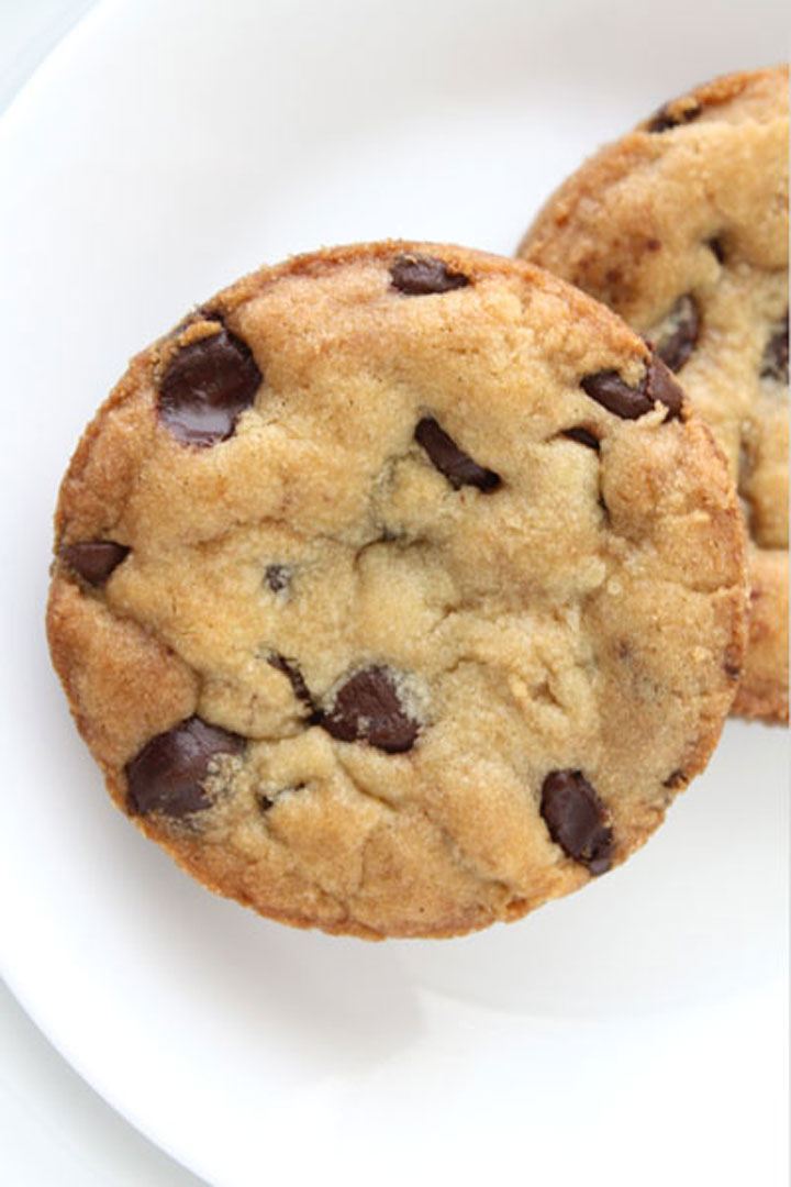 Top view of perfectly round chocolate chip cookie.