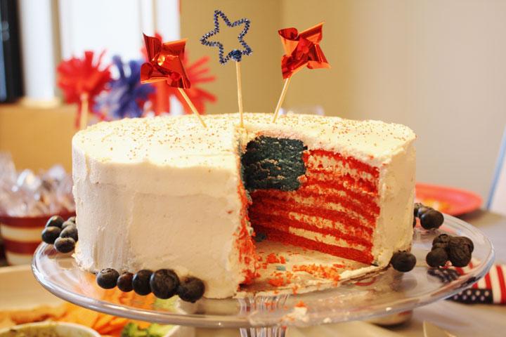 Cake sliced open to reveal American flag pattern inside.