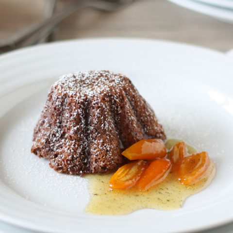 Chocolate lava cake plated with kumquat sauce