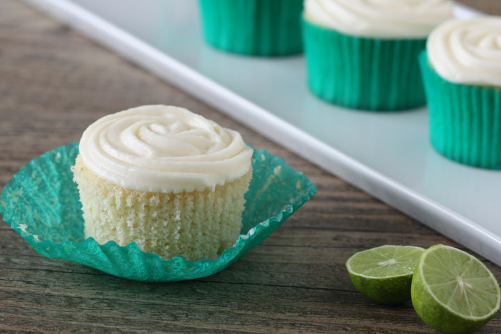 Key lime cupcake with wrapper opened.