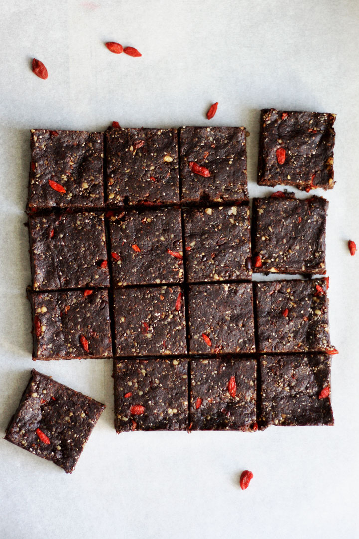 Top view of no bake superfood browniescut into 16 squares.