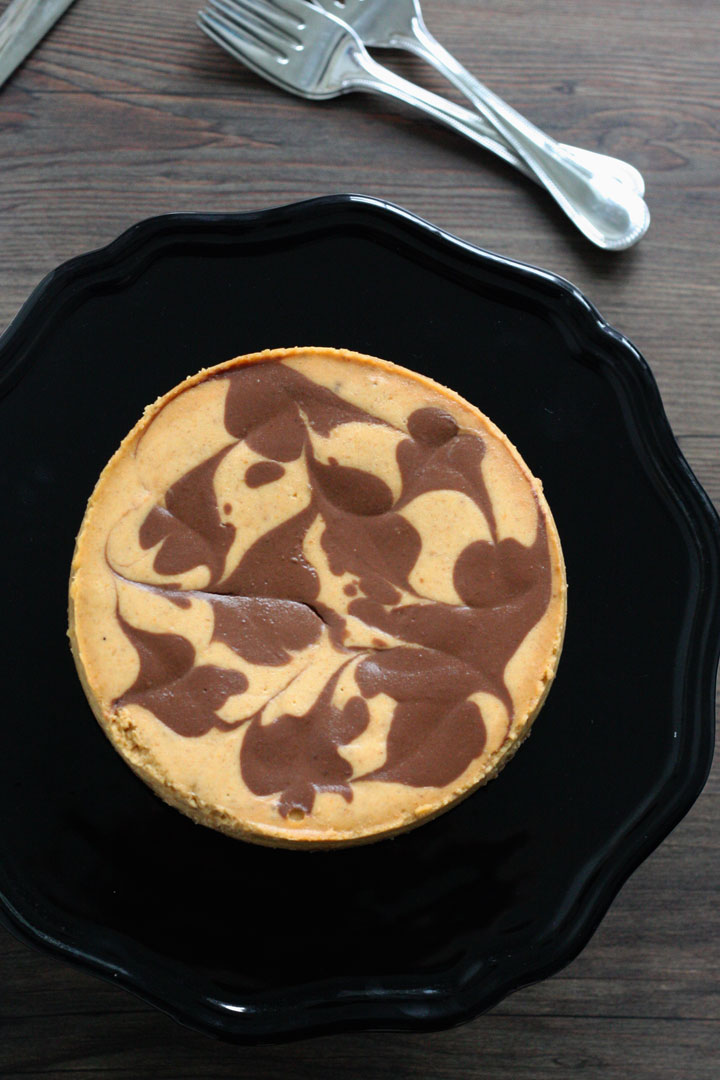 Top view of entire pupmkin cheesecake showing all the chocolate swirls.