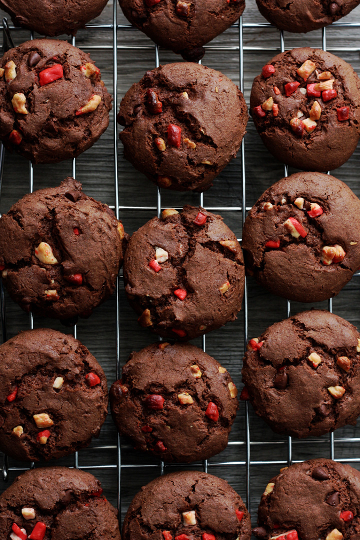 Top view of chocolate peppermint cake mix cookies cooling on metal rack.