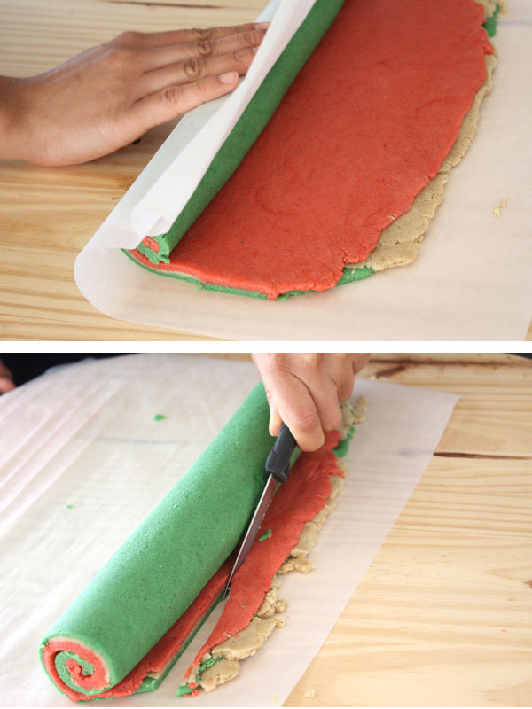 Red, green and plain cookie dough being rolled and trimmed to make Christmas Nankhatai pinwheel cookies
