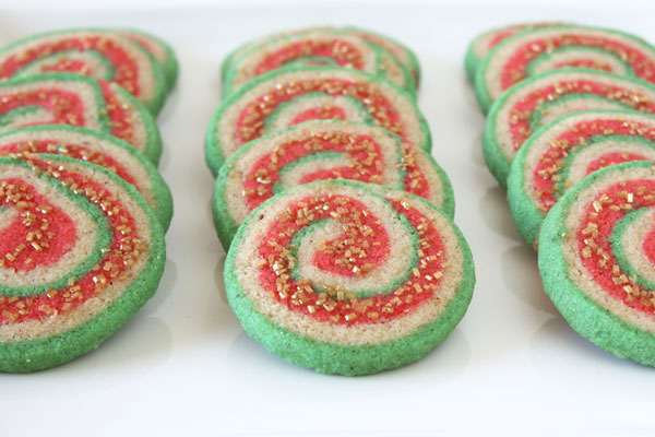 A tray of three rows of Christmas Nankhatai cookies on a white background.
