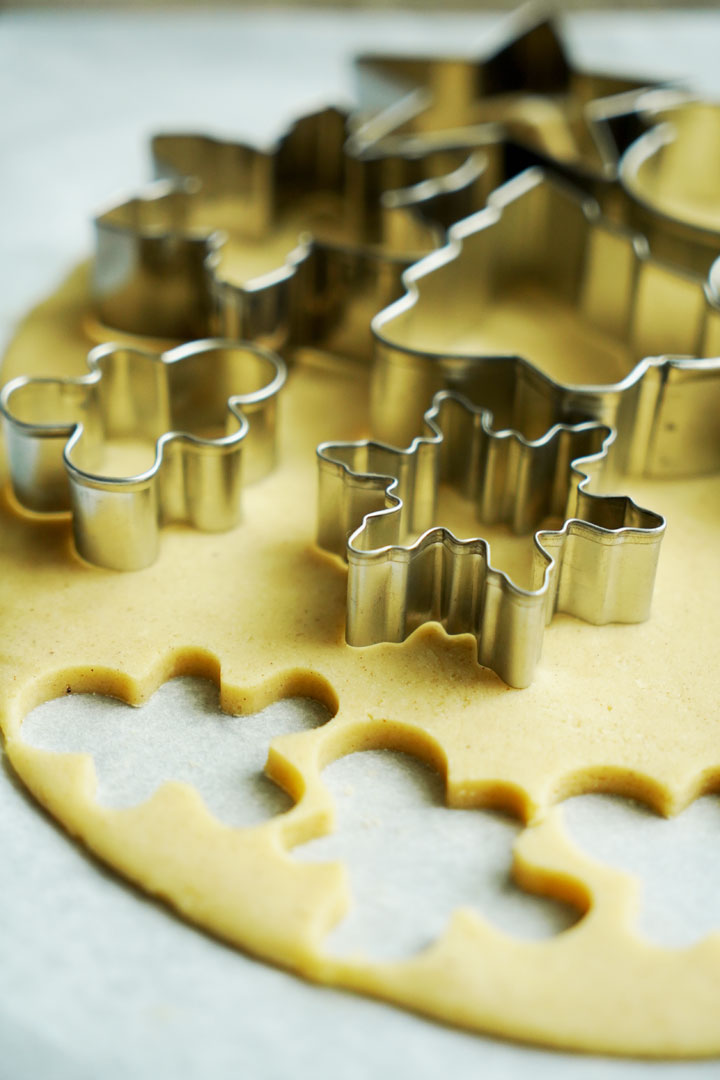 Cookie cutters on sugar cookie dough.