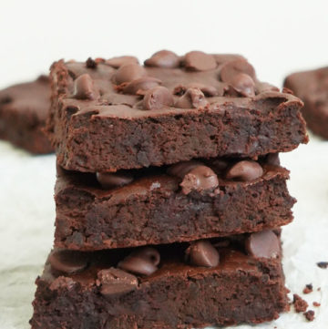 Three black bean brownies stacked on top of each other.