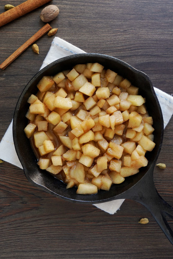 Overhead shot of cooked apples in a cast iron skillet.