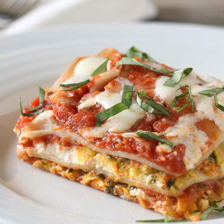 Slice of vegetable lasagna on white plate.