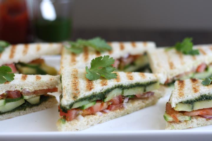 Bombay sandwich halves on a white platter.