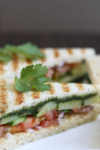 Bombay sandwich on a white plate.