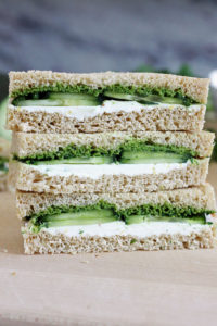 Stack of three cucumber and mint cilantro chutney teas sandwiches.