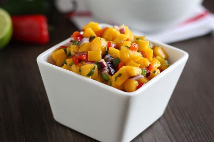 Mango salsa in a white square bowl.