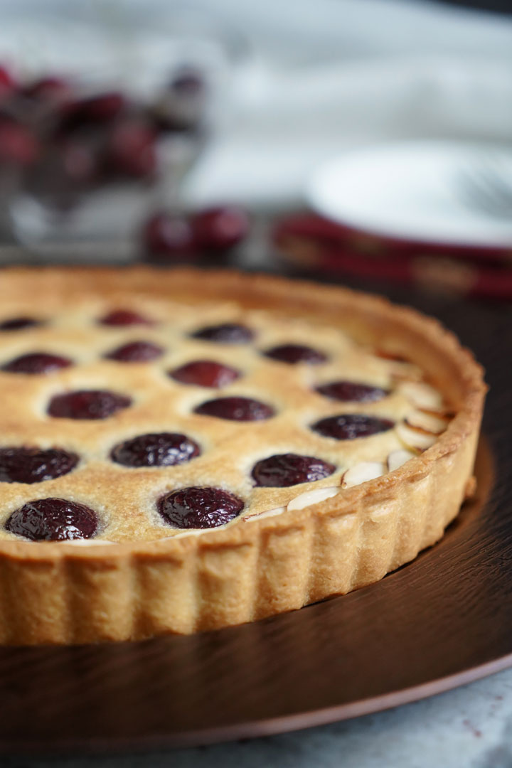 Close up view of whole cherry tart.