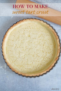 Top view of baked sweet tart crust in a tart pan.