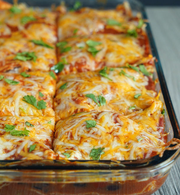 Close up view of vegetarian enchilada casserole tray.