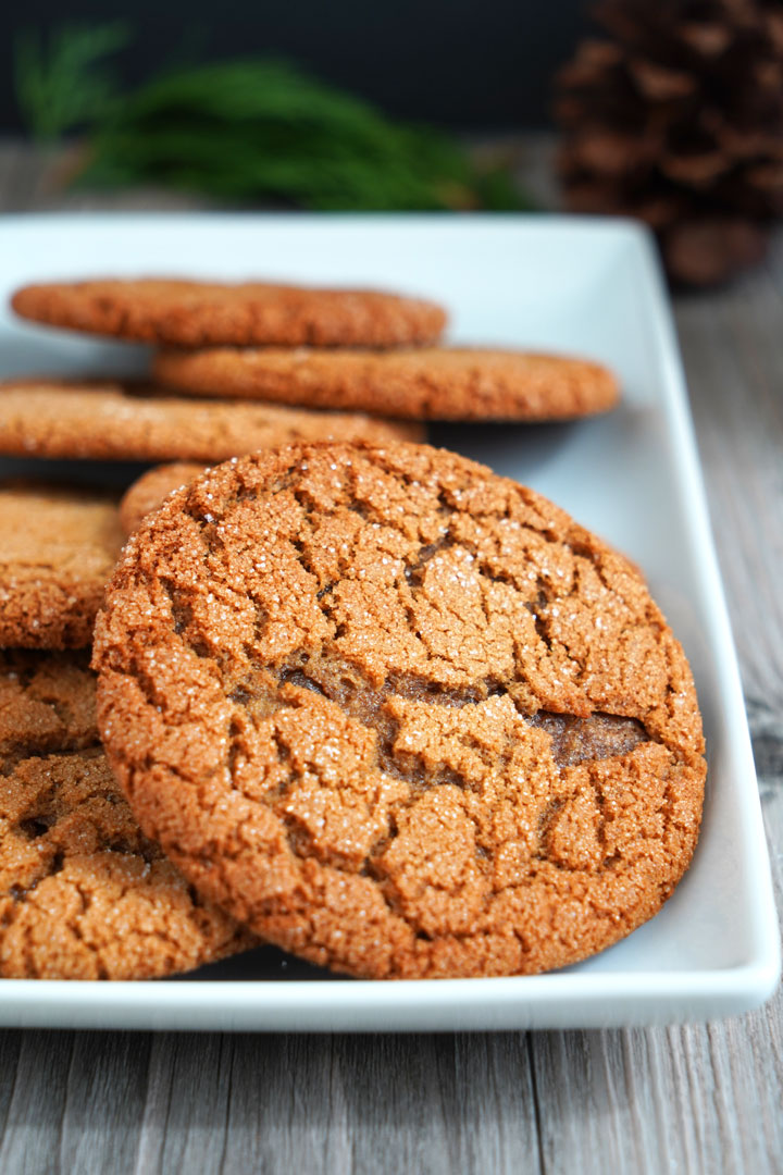 Close up view of gingersnap cookies on white tray.
