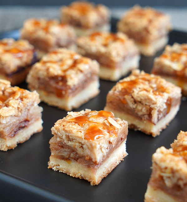 Apple Pie Bars on a black tray.