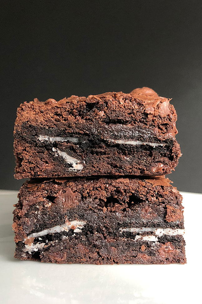 Close up detail of two Oreo stuffed brownies stacked.