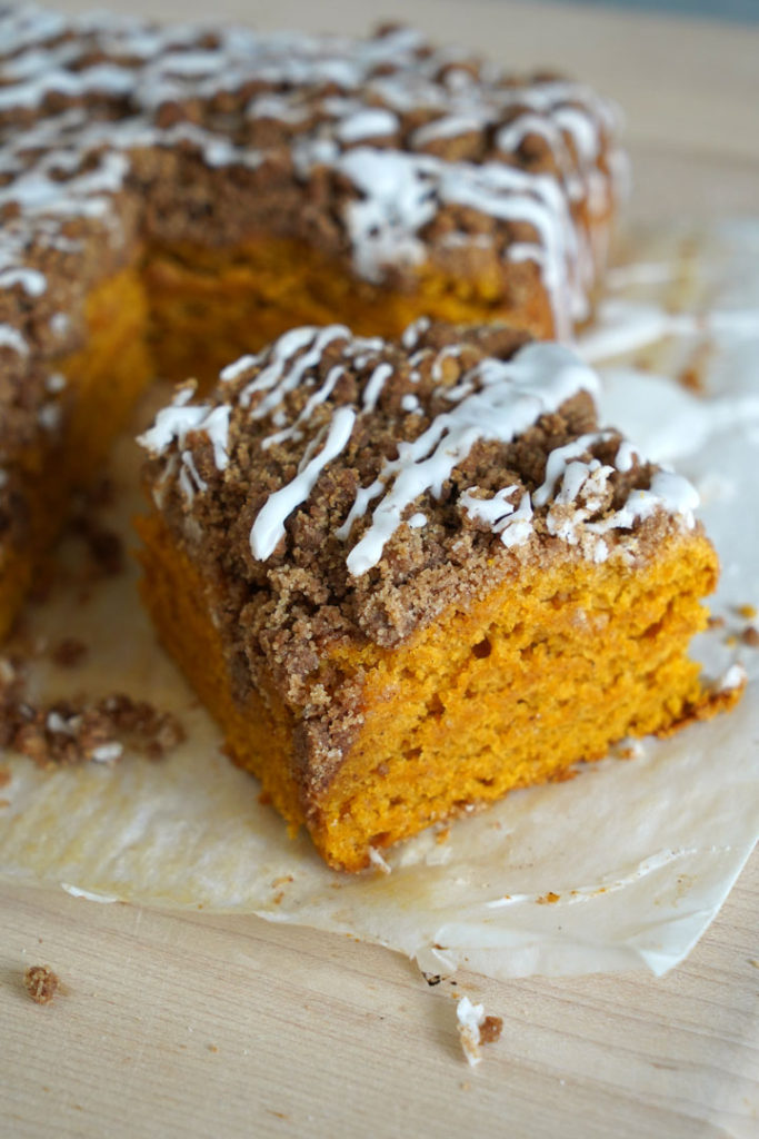 Cut piece of pumpkin coffee cake with cinnamon streusel.