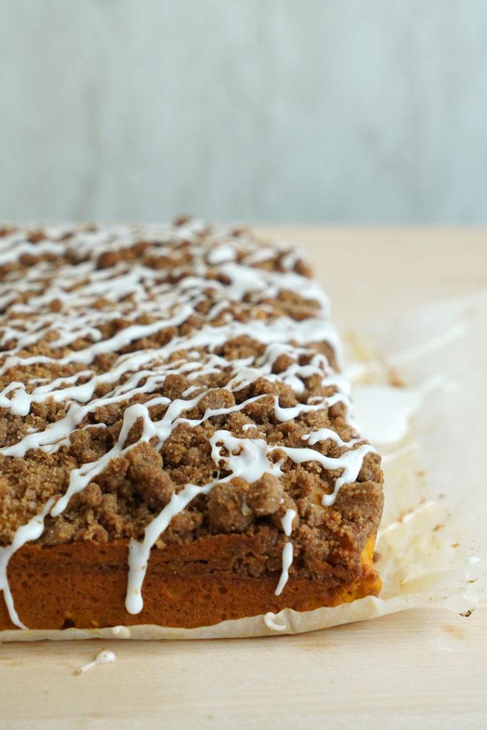 Pumpkin coffee cake with vanilla glaze.