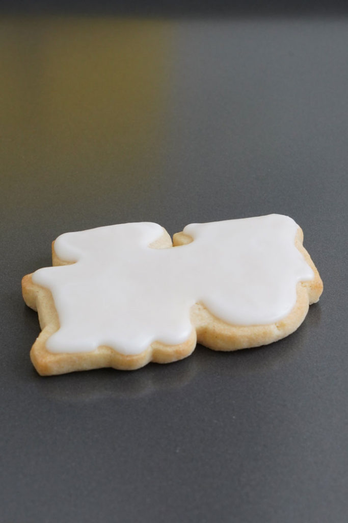 Train shaped sugar cookie in white icing.