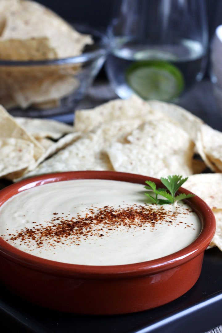 Vegan queso dip with tortilla chips.