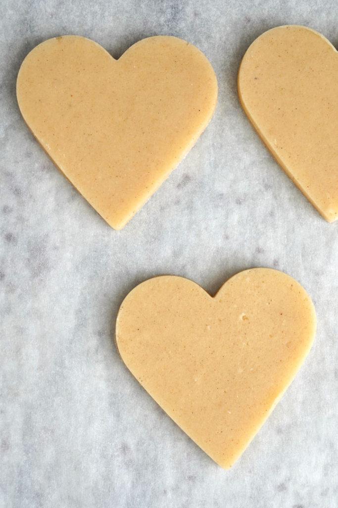 Heart shaped sugar cookie dough cut out.