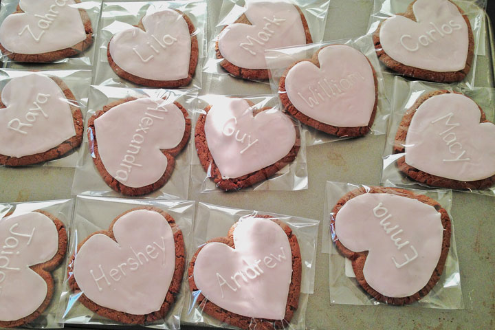Heart shaped sugar cookies personalized with names.