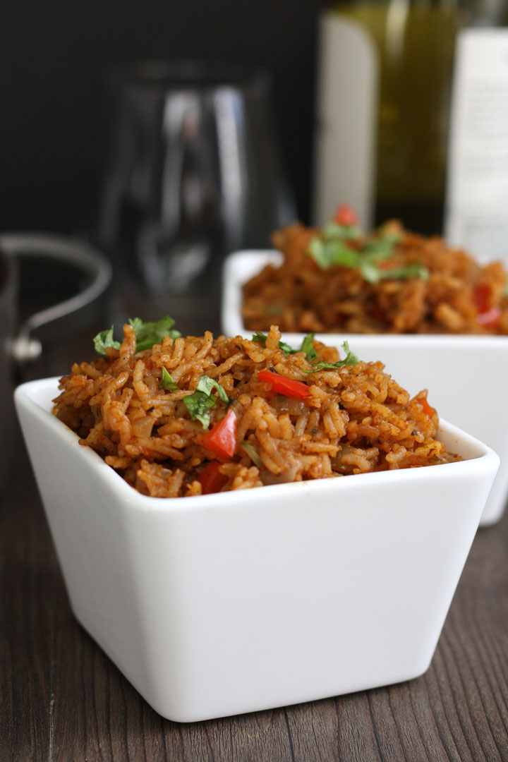 Mexican rice in white bowl.