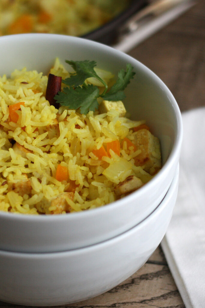 Indian fried rice in a white bowl.