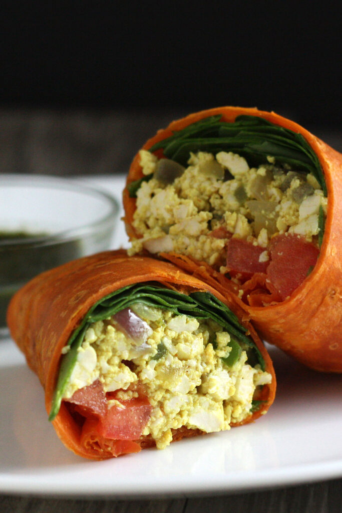 Tofu Scramble inside wrap with spinach and tomato.