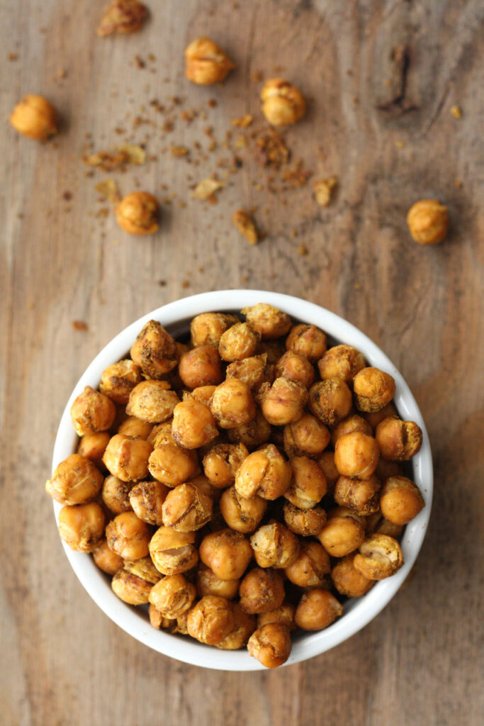 BIrd's eye view of roasted chickpeas in a white bowl.
