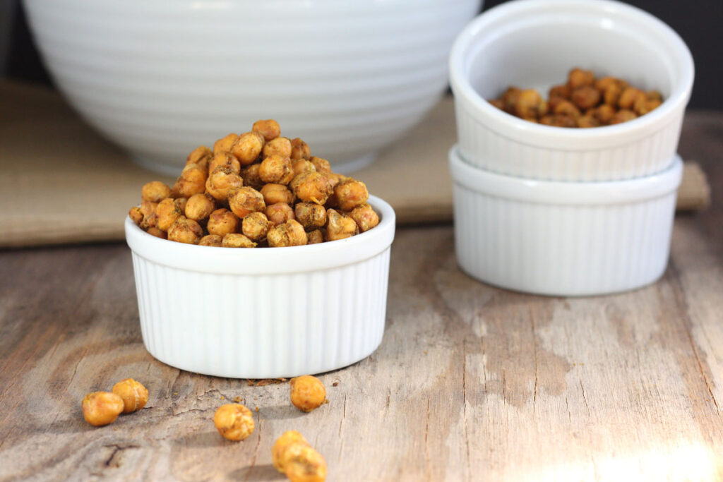 Spicy roasted chickpeas in white bowls.