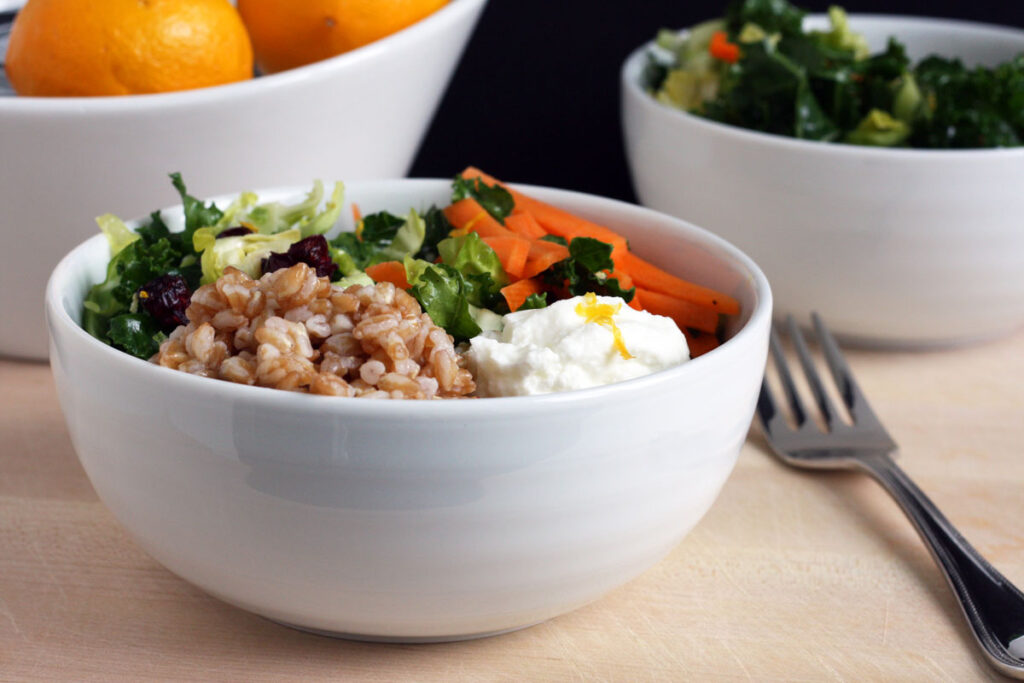 Grain bowl made with farro, shaved brussel sprouts, kale, carrots and yogurt.