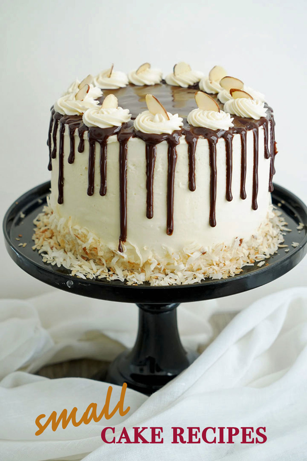 """Small almond coconut cake on a black cake stand with """"small cake recipes"""" text."""