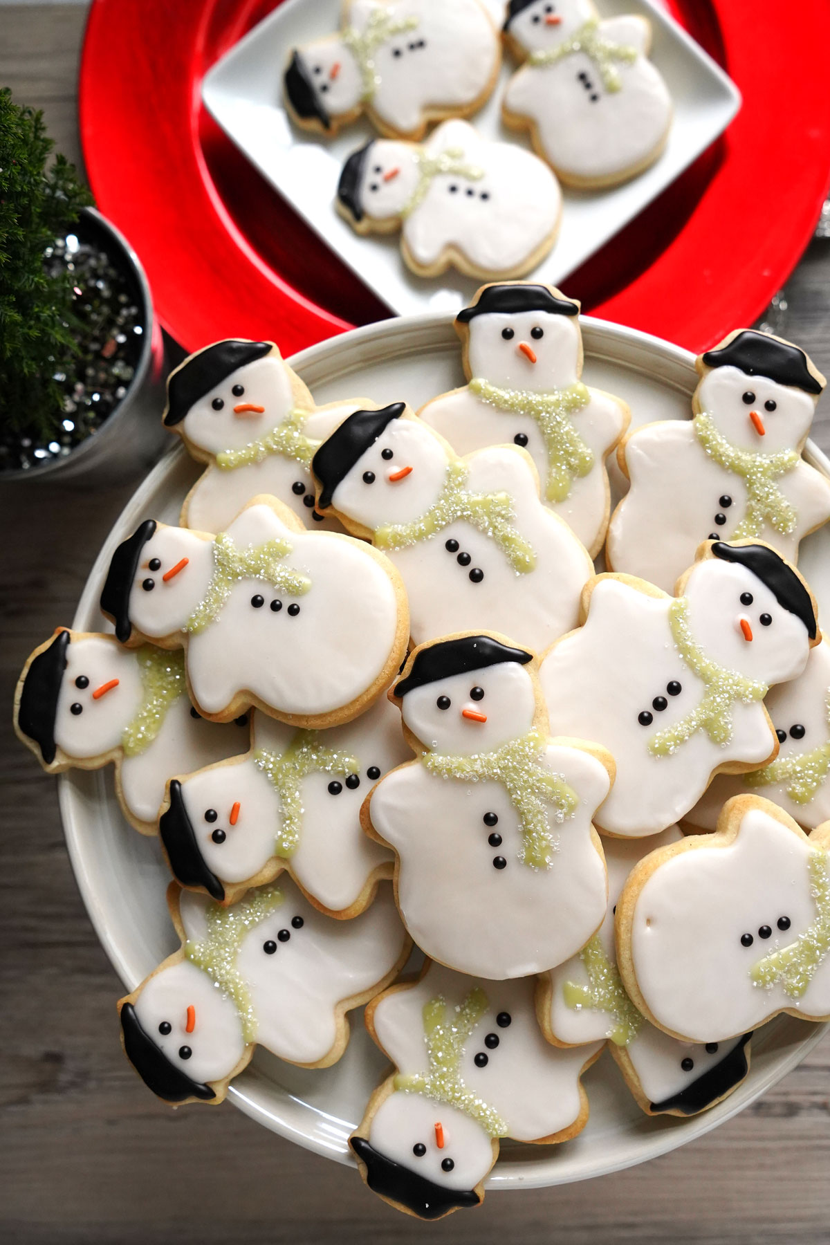 Tray of decorated snowman sugar cookies.