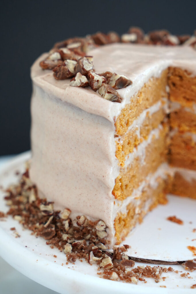 Sweet potato cake with slice vut out showing the four layered cake.