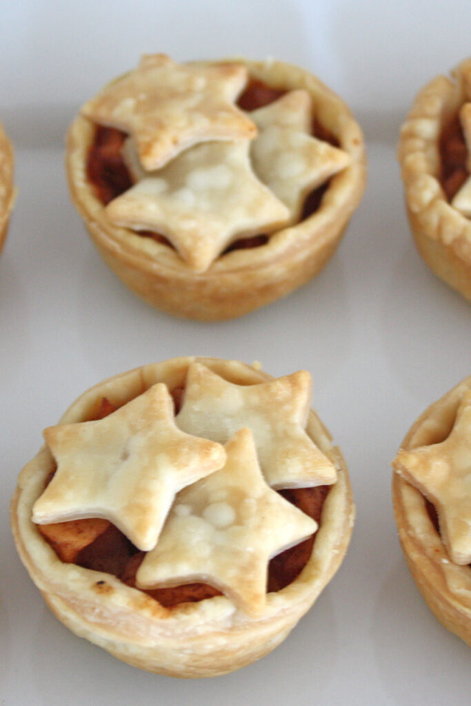 Mini apple pie with star cut outs.