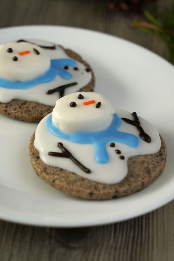 Melted snowman cookies made with cookies and cream dough on a white plate.